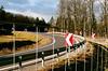 Maissau (Harald Reichmann) Tags: niederösterreich maissau landschaft wald strasse kurve zaun schwung pfeil zeichen dynamik richtung strase landstrase verkehr olympusom4 analog film mobilität