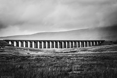 Ribblesdale... (The Frustrated Photog (Anthony) ADPphotography) Tags: architecture category england landscape northyorkshire places ribblesdaleviaduct travel yorkshire battymossviaduct monochrome mono blackandwhite whiteandblack bw bridge railway rain sky dale hills travelphotography landscapephotography canon canon1585mm canon70d grass clouds arches stone outdoor field viaduct lines