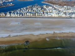 A snow-covered Manasquan Beach and the Atlantic Ocean, captured by a DJI Phantom 4 drone. (apardavila) Tags: atlanticocean djiphantom4 jerseyshore manasquan manasquanbeach manasquaninlet manasquanriver aerial beach beachfronthomes drone morning rocks sky snow waves