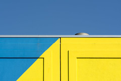 Blue and yellow geometry (Jan van der Wolf) Tags: map15195vv blue blauw yellow geel building geometric geometry geometrisch geometrie sky gevel apartmentbuilding facade architecture architectuur lines lijnen
