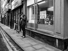 Northern Quarter 189 (Peter.Bartlett) Tags: manchester niksilverefex shopfront unitedkingdom people wall facade doorway urbanarte olympuspenf poster cellphone streetphotography lunaphoto man urban shopwindow monochrome uk m43 microfourthirds mobilephone bw peterbartlett sign blackandwhite candid city england gb