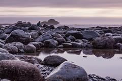 Long Exposure at Sombrio (Joel Apple) Tags: seaweed sombriobeach vancouverisland ocean algae northamerica rocks sun longexposure sunset lowtide pacificnorthwest britishcolumbia pacific clouds