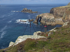 Recording wind chimes by Pordenack Point, with view over Enys Dodnan & Armed Knight (Philip_Goddard) Tags: europe unitedkingdom britain british britishisles greatbritain uk england southwestengland cornwall penwith landsendpeninsula landsend pordenackpoint views scenery landscapes coastpath coast southwestcoastpath nationaltrail southwestway westcoast recording windchimes enysdodnan armedknight rockisland naturalarch