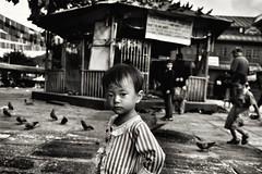 Kathmandu, Nepal (paola ambrosecchia) Tags: streets blackandwhite asia child streetphotography nepal kathmandu portrait face eyes travel bnw monochrome amazing reportage documentary ritratto