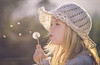 Summer wishes (Red Gecko Photography) Tags: dandelions seeds mountain girls blowing wishes portrait back light