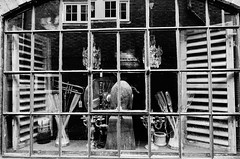 Antique Reflections (Henry Hemming) Tags: antique items crafts sale sell shop window reflections rye sussex bw black white objects objets blackwhite ephemera artefacts household image glass screen hidden