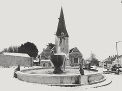 The Fountain Braintree (Herb287) Tags: braintreefountain braintree essex blackandwhite unlimitedphotos theamateursgroup snow ice mono monochrome black white grey statue fountain water icicle icicles samsung stmichaelschurch churchofengland spire dioceseofchelmsford