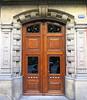 Banded doorway, Barcelona (Spencer Means) Tags: dwwg door wood glass ironwork doorway stone carved carving band dreta eixample barcelona catalunya catalonia spain