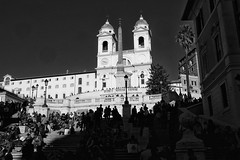 Enjoying the sun (halifaxlight (back in April)) Tags: italy rome spanishsteps trinitàdeimontichurch church steps people silhouettes standing sitting walking towers sunny shadows urban bw trees lampposts obelisk