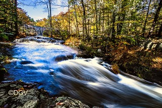 New England flowing water in the Fall with foliage.
