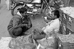 A lot can happen over a cup of tea (Rahul Gaywala) Tags: monochrome people candid street fujifilm xt2 surat vibrant diamond city flower market flowermarket
