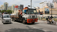 Singapore JIB Hoists (Jungle Jack Movements (ferroequinologist)) Tags: truck mount jib crane lift lifter rig rigger flat tp wooden sides hino 700 isuzu giga kim soon lee buildmate building supply transport singapore seragoon road mustafa tractor prime mover diesel injected motor engine driver cab cabin brake wheel exhaust loud rumble horsepower oil haul haulage freight cabover trucker carry delivery bulk lorry hgv wagon trailer deliver cargo interstate vehicle load freighter ship move power teamster coe rochor asia