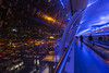 The airport at night (Blue Rock Fox) Tags: airport lights blue night nightphotography publictransport pedestrians bridge pedestrianwalkway building design architecture cars carpark manchester manchesterairport airportterminal airlinepassengers airlines travel travelator travellator movingwalkway travellers people