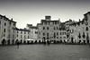 Lucca: Piazza Anfiteatro (Darea62) Tags: lucca town street history people tuscany toscana anfiteatro square piazza borgo buildings ancient pavement renaissance architecture arch circus blackwhite blackandwhite