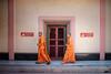 Walking monks (Goran Bangkok) Tags: bangkok thailand chinatown mangkon kamalawat temple monk monks orange door pink