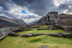 Dolbadarn Castle Snowdonia (Adrian Evans Photography) Tags: grass welsh snowdonia historic dinorwicslatequarry monument cadw lake dolbadarn welshcastle dolbadarncastle wales edwardian dinorwigquarry uk northwales quarry architecture castle landscape llanberis landmark outdoor clouds llanberispass ruins january britain padarn adrianevans ancient snowdonmoutainrange heritage hills snowdon british sky mountain