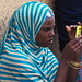 Somali fiddling with her phone -Kafira market