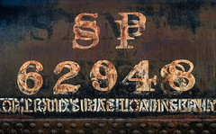 Bemusion (Junkstock) Tags: aged corrosion corroded california campo decay decayed distressed graphics graphic industrial industry number numbers patina paint rust rusty rusted railroad relic rivets type typography texture textures text transportation transport trains train weathered