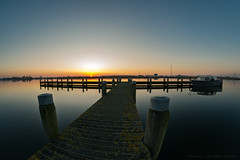 Sunset near River Rotte (mesocyclone70) Tags: wide wideangle fisheye 8mm samyang ultrawide sunset water reflections depth sky river rottemeren zevenhuizen bleiswijk holland zuidholland netherlands sun blue depthoffield