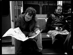in the news (Chris Blakeley) Tags: seattle hipstamatic candid streetphotography reader reading read newspaper bnw