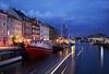 Nyhavn in Copenhagen (ArtDen82) Tags: copenhagen architecture autumn design denmark scandinavia nyhavn longexposure nightlights sunset boat water