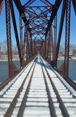 Following the tracks of cold, lonely, and desolate. (Counselman Collection) Tags: counselman mcclure ohio grandrapids grand rapids railroad rails tracks train bridge old iron cold lonely desolate river sun