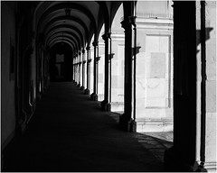 Ray in the Shade (Thomas Listl) Tags: thomaslistl blackandwhite noiretblanc biancoenegro architecture contrast light sunlight shadows portal alley corridor passage arcade juliusspital würzburg diagonal geometry vanishingpoint 50mm monochrome
