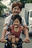 Brotherhood (-clicking-) Tags: streetphotography streetlife streetportrait children childhood childish childlike vietnamesechildren brotherhood brother sister smile happiness happymoment happy innocence innocent life dailylife enjoy saigon vietnam