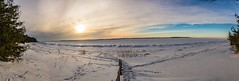 The East Bay, coast to coast . . . (Dr. Farnsworth) Tags: sunset eastbay grandtraverse panorama vertical clouds sun blue sky beach snow ice railing township park traversecity elkrapids mi michigan winter february2018