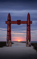 A gate big enough for the moon (ajecaldwell11) Tags: xe3 awatoto sunset ankh water moon celestialcompass pou clouds pathway hawkesbay waitangi napier fujifilm fullmoon dusk sky gate newzealand caldwell ateaarangi light