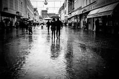 Rainy (AlphaAndi) Tags: mono monochrome urban leute people personen portrait menschen menschenbilder trier tiefenschärfe wow water rainy regnerisch regen rain dof streets streetshots streetshooting streetportrait fullframe vollformat