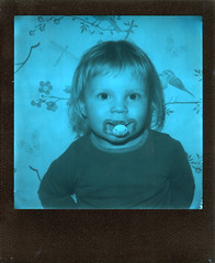The Pacifier (Magnus Bergström) Tags: polaroid 680 slr polaroid680slr analog instant film 600 foldable originals polaroidoriginals duochrome black blue blackandblue portrait kid girl sweden sverige värmland wermland sunnemo child majber00