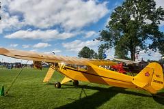 Piper Cub (Edward Mitchell) Tags: piper cub airplane fabric clouds sky yellow lightplane aviation oshkosh airventure eaa