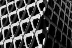 2010-10-21a Two sides ([Ananabanana]) Tags: nikon d40 gimp photoscape 1855mm 1855 nikkor nikon1855mmkitlens nikkorafsdx1855mm nikonafsdx1855mm nikkor1855mm nikon1855mm nikonistas nikonista uk unitedkingdom london marylebone westminster oxfordstreet oxfordst oxfordcircus welbeckstcarpark carpark debenhams brutalist brutalism 1970s futuristic concrete triangles tessellations tessellate tessellated tessellating triangular polygons orton geometric lines architecture monochrome symmetry bw blackandwhite blackwhite