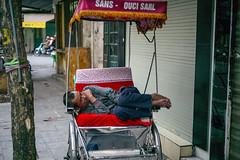 Stolen moments (NikosLiapis) Tags: vietnam hanoi street cyclo sleeping insouciant man cozy nap red nikosliapis leicamptyp240 leicasummicronm50mmf2 asia candid resting pause carefree transport urban yellow green 50mm leica day exterior outside colourful