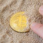 Bitcon in sand thumbnail