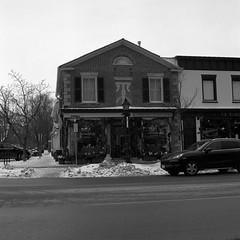 A Little French (Alex Luyckx) Tags: niagaraonthelake ontario canada downtown urban town historic historicdowntown canadianhistory niagara newark winter snow offseason shawfestival hasselblad hasselblad500c slr 120 mediumformat 6x6 carlzeiss carlzeissplanar80mm128 ilford ilfordfp4 fp4 asa125 kodak kodakd76 d76 stock bw blackwhite gossenlunasixf epsonv700 adobephotoshopcc film filmphotography squareformat believeinfilm filmisalive filmisnotdead fp4party