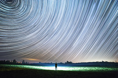 Cosmic Contemplation (Matt Molloy) Tags: mattmolloy timelapse photography timestack photostack movement motion night sky stars trails lines circles spin me myself silhouette light airplanes field trees ontario canada landscape nature countryside lovelife violet