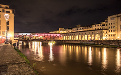 Ponte Vecchio sull'Arno - Firenze (Italy) (Andrea Moscato) Tags: andreamoscato italia toscana tuscany nuvole clouds sky cielo city città town ponte bridge fiume river arno reflection riflesso water acqua freshwater dark downtown darkness light luci shadow ombre view vivid vista yellow green grass history historic ancient buildings house architecture architettura arco art arte artist