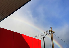As the Sky Unfolded (Keith Midson) Tags: rainbow sky servicestation urban powerpole powerlines red architecture clouds hobart tasmania