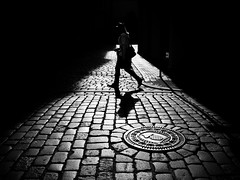 spotlight (Sandy...J) Tags: olympus oldtown monochrom fotografie noir mono sonnenlicht cobblestones atmosphere alone atmosphäre walking walk man mann photography light licht darkness street streetphotography sw schwarzweis strasenfotografie stadt silhouette shadow sunlight strase schatten blackwhite bw black city contrast germany deutschland gegenlicht backlight
