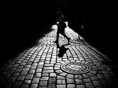 spotlight (Sandy...J) Tags: olympus oldtown monochrom fotografie noir mono sonnenlicht cobblestones atmosphere alone atmosphäre walking walk man mann photography light licht darkness street streetphotography sw schwarzweis strasenfotografie stadt silhouette shadow sunlight strase schatten blackwhite bw black city contrast germany deutschland gegenlicht backlight
