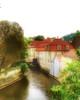 A canal runs through Prague. (Fotofricassee) Tags: pastel stucco czech waterway canal prague
