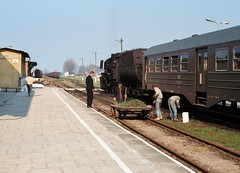 Mazuria PKP  |  1991 by keithwilde152 - Steam traction and work party endeavours complete the rural idyll at Wegorzewo where Korsze's 'Kriegslok' Ty42-33 heads the  09.00 departure to Ketrzyn. Once a five-way junction in the former East Prussia, by 1914 formerly Angerburg (ostpr) had routes radiating to Gumbinnen, Goldap, Lotzen and Rastenburg. The depot building Bw Angerburg (Rbd Konigsberg) survives in private use located near to the station.  In a run of 1990s line closures the Wegorzewo branch lost its passenger service in May 1992 but continued to transport freight until the Millennium. 35mm / Kodak Ektar 100 29th April 1991