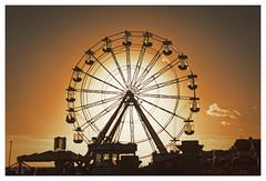 Wheel of Gold (Myrialejean) Tags: bridlington eastriding eastcoast seaside seasons winter golden wheel fair sunset