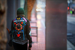 War Is Over (Ian Sane) Tags: ian sane images warisover ifyouwantit woman jacket colorful train station max candid street photography downtown portland oregon bokeh canon eos 5ds r camera ef70200mm f28l is usm lens