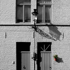 next door neighbor (sculptorli) Tags: bruges windows doors neighbor shadow belgië belgium belfonthallen westvlaanderen brugge westflanders bruggas brvggas brvccia