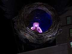 Kid in a Birds Nest on the Theater Roof - Harry Potter and the Cursed Child  7224 (Brechtbug) Tags: kid birds nest theater roof harry potter cursed child lyric theatre broadway wizard blue feather lights marquee shadow cutout between 7th 8th avenues 43rd street live version film poster new york city 02202018 nyc 42nd st ad advertisement pop popular art mural parts one two pt 1 pts 2 fake mannequin