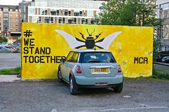 We Stand Together, Manchester, UK (Robby Virus) Tags: manchester england uk unitedkingdom britain greatbritain mural street art car bee we stand together mcr yellow