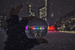 (A Great Capture) Tags: toxo urban lights snowing holding man downtown snow winter reflection nathanphillipssquare photoshop night crystal ball hand sign toronto nathan phillip square city hall neige schnee streetphotography streetscape photography streetphoto street calle architecture architektur arquitectura design vibrant colorful cheerful vivid bright outdoor outdoors cityscape urbanscape eos digital dslr lens canon t5i colours colors colourful agreatcapture agc wwwagreatcapturecom adjm ash2276 ashleylduffus ald mobilejay jamesmitchell on ontario canada canadian photographer northamerica torontoexplore l'hiver 2018 torontosign